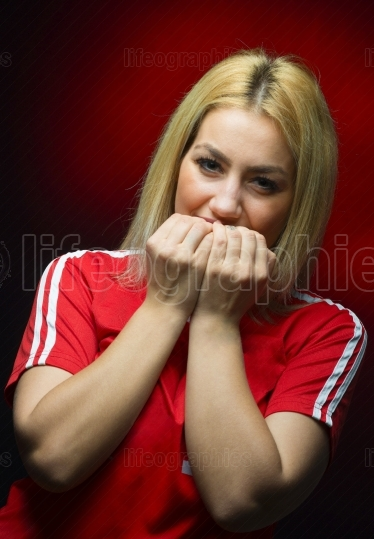 Woman fan with emotions for her team
