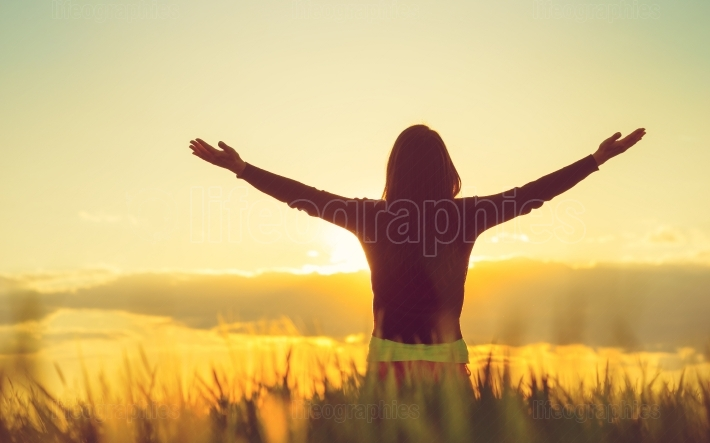 Woman feeling free in a beautiful natural setting