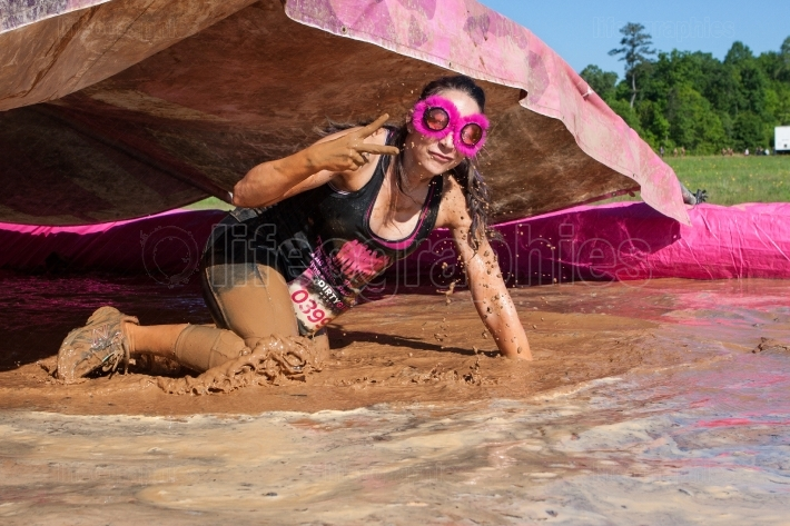Woman Flashes Peace Sign At Dirty Girl Mud Run Event