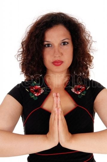 Woman folding hands and praying.