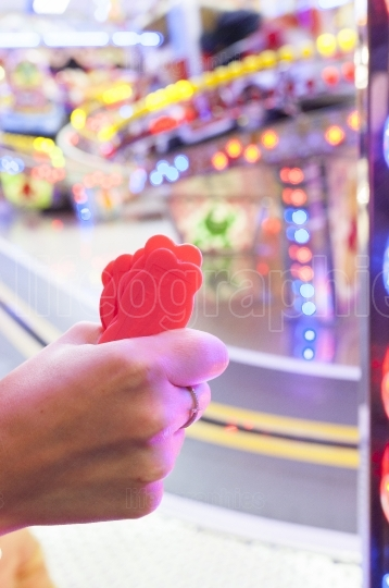 Woman hand with a fistfull of chips for fair ground ride childre