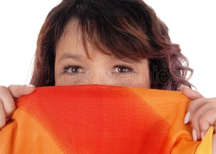 Woman holding scarf over mouths