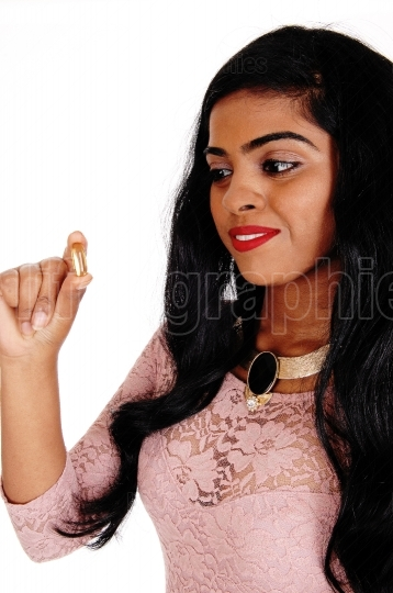 Woman holding vitamin pill.