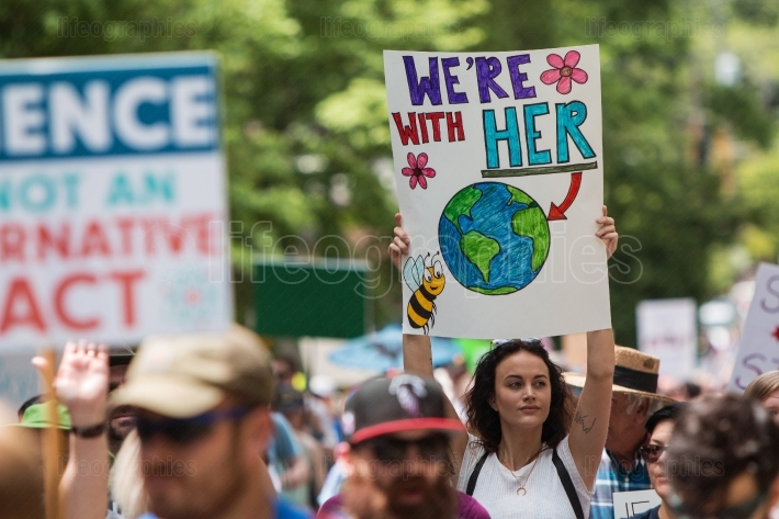 Woman Holds Up Sign Marching At Atlanta Earth Day March