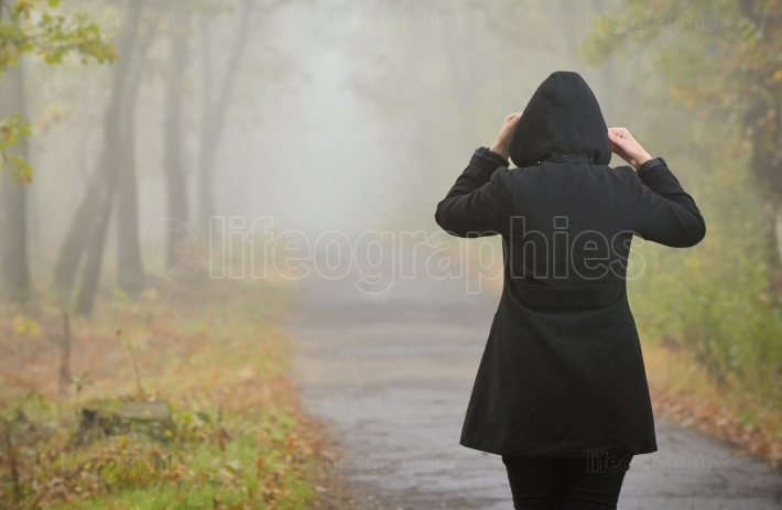 Woman In A Foggy Forest