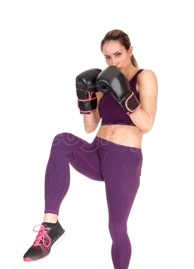 Woman in action boxing in exercise outfits