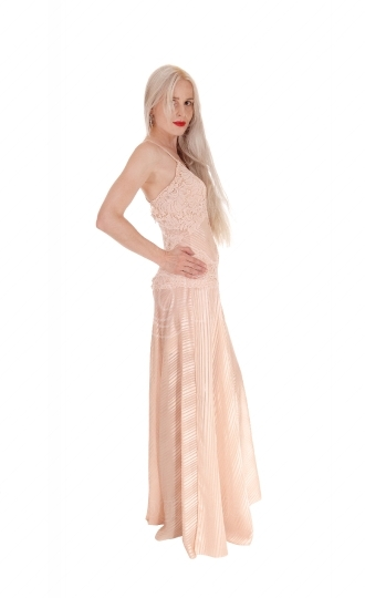 Woman in long pink dress standing