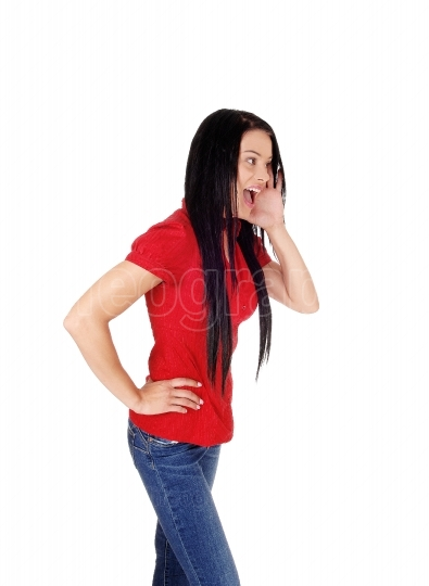 Woman in red blouse and black hair screaming