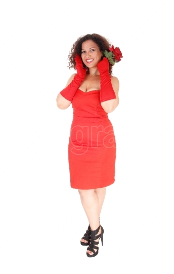 Woman in red dress and red cloves.