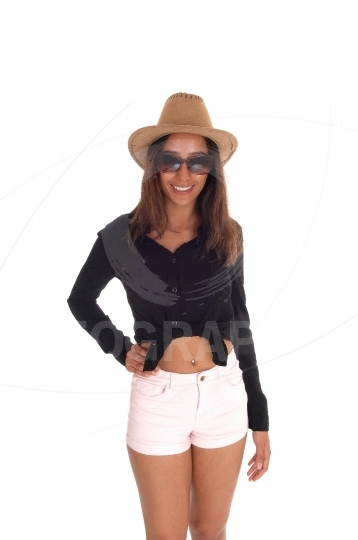 Woman in shorts, hat and sunglasses