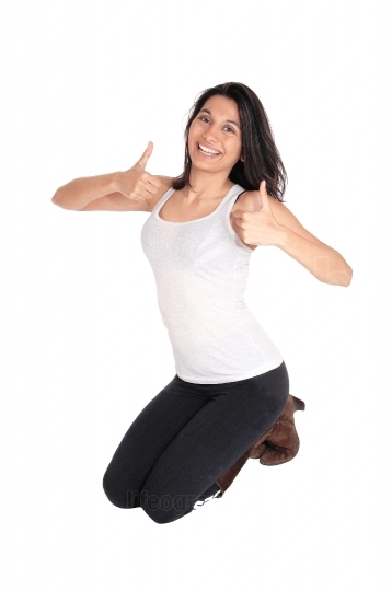 Woman kneeling with thumps up