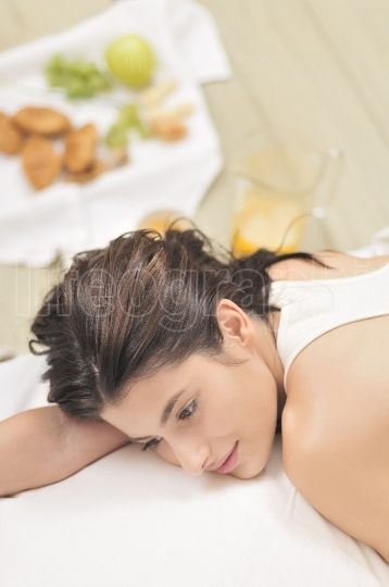 Woman laying on bed after  having breakfast