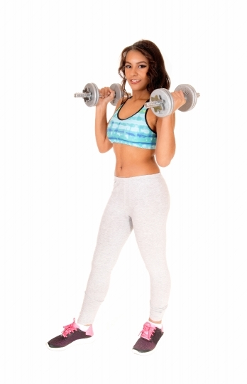 Woman lifting dumbbell s