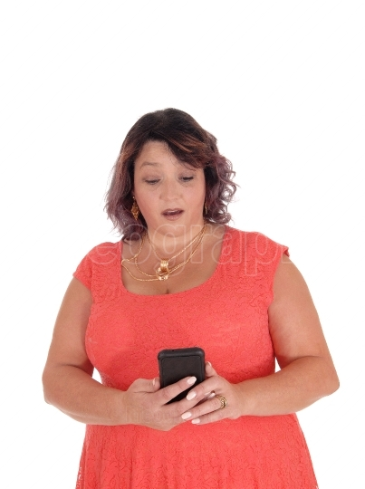 Woman looking surprised at her cell phone