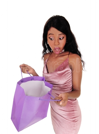 Woman looking surprised in her shopping bag