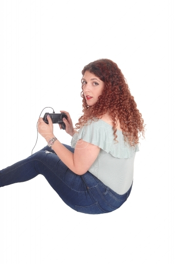 Woman playing her video game