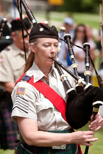 Woman Plays Bagpipes At Spring Festival