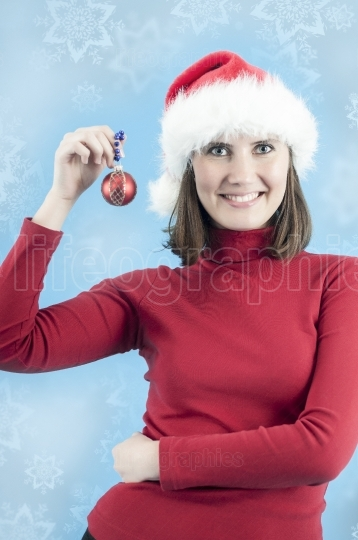 Woman ready to decorate the christmas tree