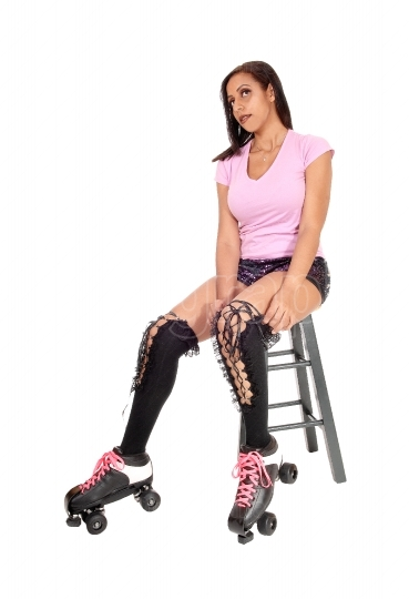 Woman resting on chair with roller skates