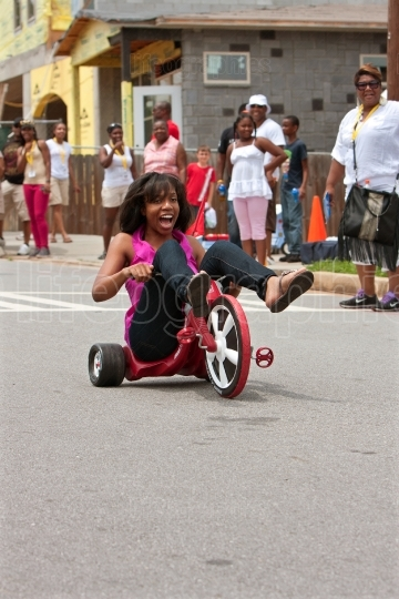Woman Rides Big Wheel Tricycle Down Atlanta Street