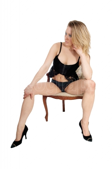 Woman sitting in lingerie.