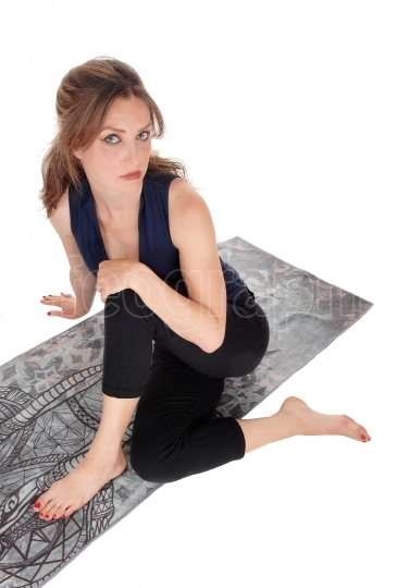 Woman sitting on floor and looking up
