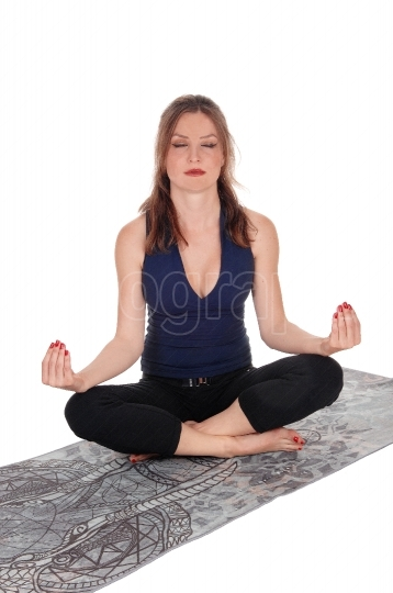 Woman sitting on floor in yoga position