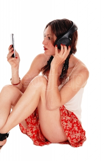 Woman sitting on floor with headset