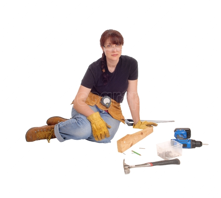 Woman sitting with her tools.