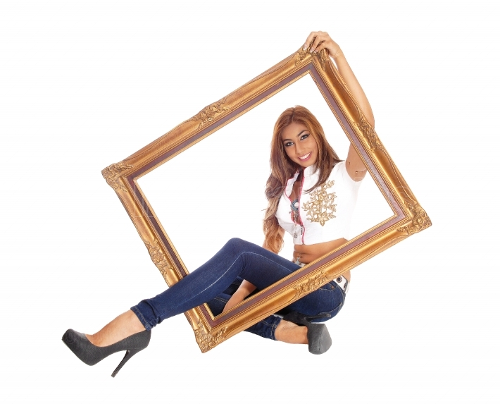 Woman sitting with picture frame.