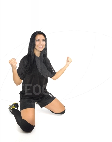 Woman soccer player isolated over white