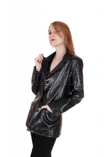 Woman standing in black leather jacket
