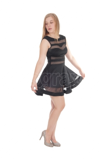 Woman standing in short black dress