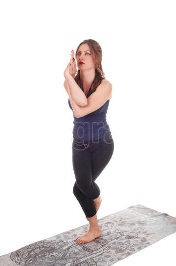 Woman standing on one leg and arms twisted