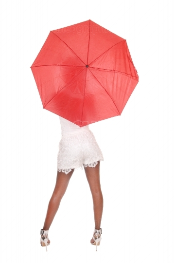 Woman standing with a red umbrella
