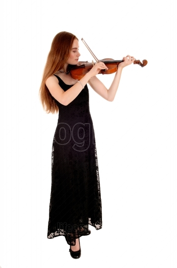 Woman standing with violin