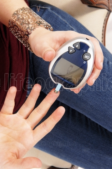 Woman testing her blood sugar