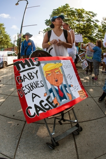 Woman Transports Anti Trump Sign In Baby Stroller At Rally