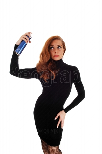 Woman using hair spray