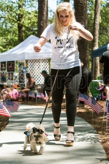 Woman Walks Dog In Canine Fashion Show