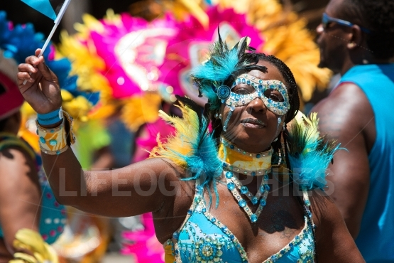 Woman wearing costume participates in parade celebrating caribbe