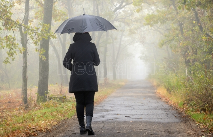 Woman with black umbrella