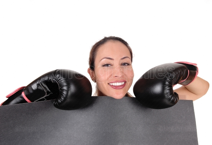 Woman with boxing gloves looking smiling