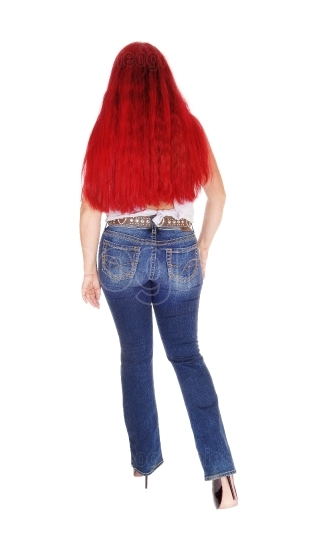 Woman with long red hair from back.