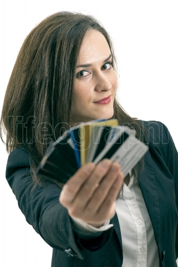 Woman with many different credit cards. Isolated on white.