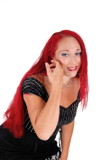 Woman with red hair bending down.