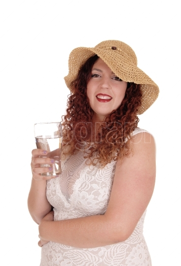 Woman with straw had and glass of water