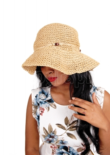 Woman with straw hat looking down.
