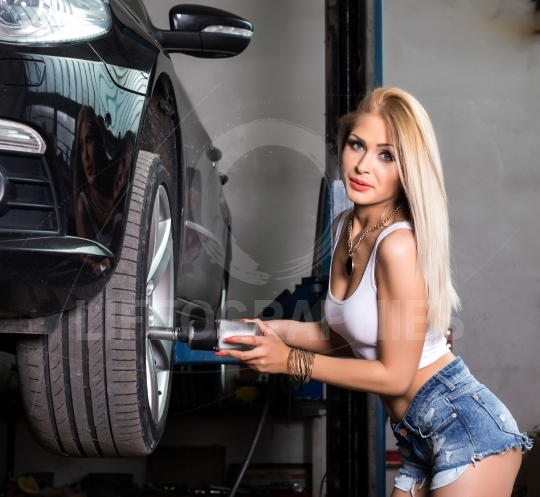 Woman working at a car