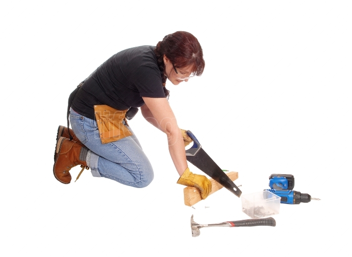 Woman working with her saw.